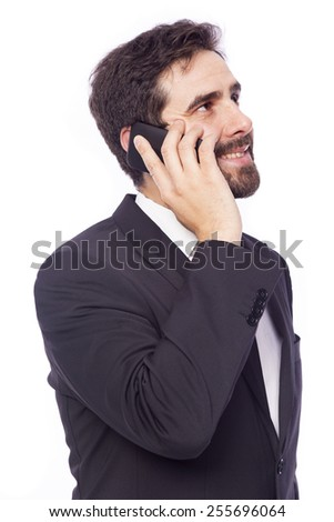 Handsome business man talking on the phone, isolated on white background - stock photo