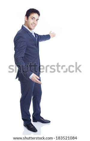 Handsome business man with arm out in a welcoming gesture, isolated on white - stock photo