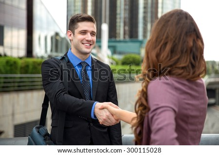 Handsome businessman attorney greeting new employee team colleague client handshake - stock photo