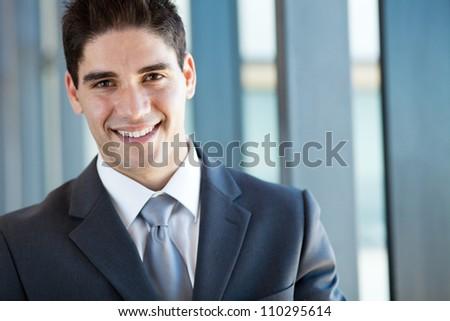handsome businessman closeup portrait in office - stock photo