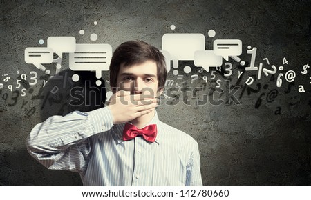 Handsome businessman closing his mouth with palms - stock photo