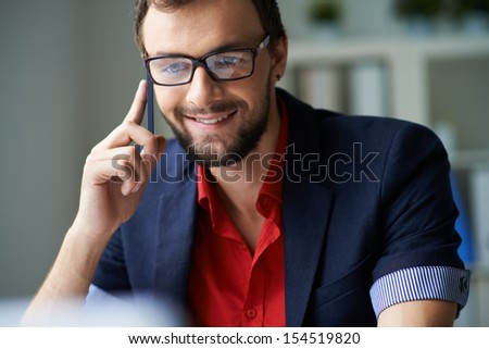 Handsome businessman consulting clients on the phone - stock photo