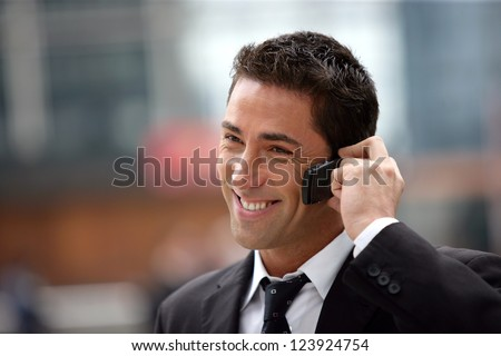 handsome businessman having phone call - stock photo