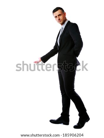 Handsome businessman hold hand welcome gesture over white background - stock photo