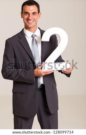 handsome businessman holding number 2 - stock photo