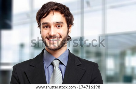 Handsome businessman in a modern office - stock photo
