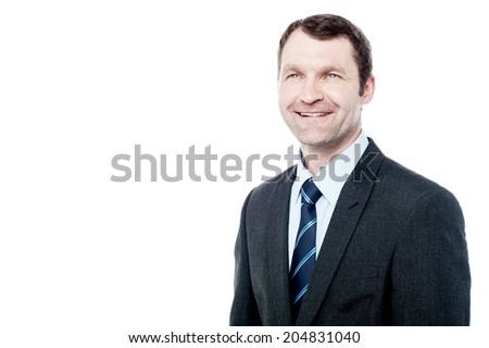 Handsome businessman in a suit and looking up