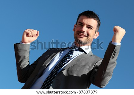 handsome businessman in blue sky in summer - stock photo