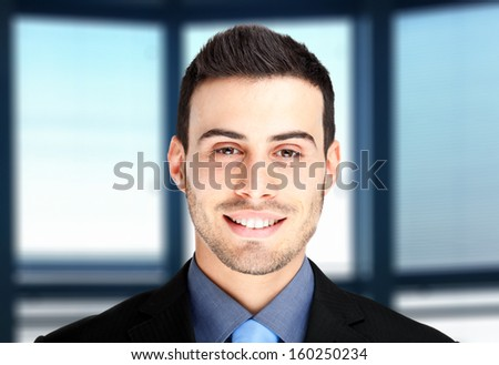 Handsome businessman in his office - stock photo