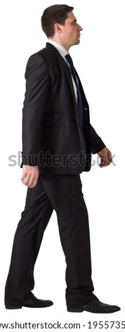 Handsome businessman in suit stepping on white background