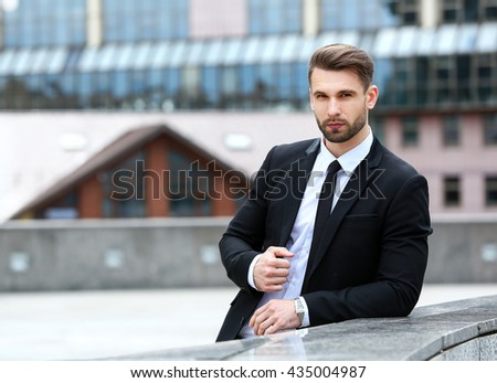 Handsome businessman is waiting for his client