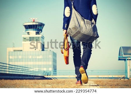 Handsome businessman is walking at the airport  - stock photo