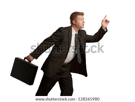 Handsome businessman moving with briefcase isolated on white background - stock photo