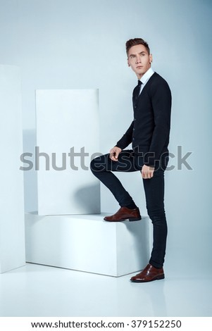 Handsome businessman posing on light background. young attractive and confident man