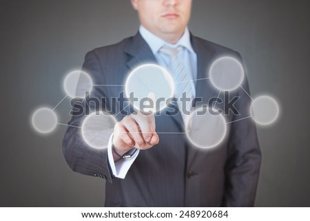 Handsome businessman pressing high tech (modern) button touch interface (virtual) - with place for logo, text or product