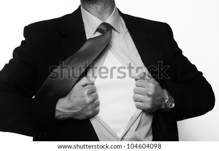 handsome businessman pulling his shirt apart doing a superhero businessman poses