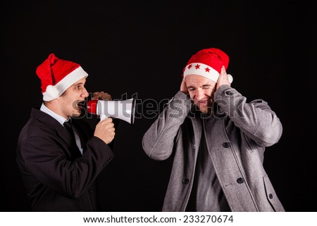 handsome businessman screaming in megaphone - stock photo