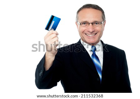 Handsome businessman showing his credit card to camera