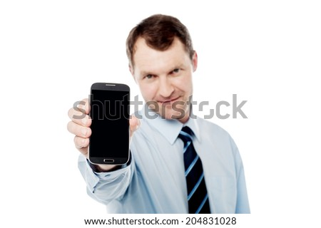 Handsome businessman showing his smart phone - stock photo