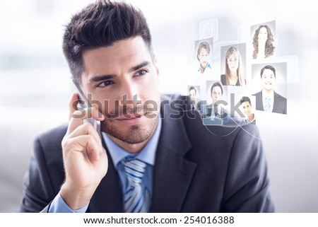 Handsome businessman sitting on sofa making a call against profile pictures - stock photo