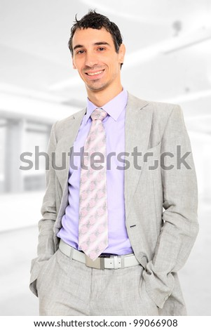 Handsome businessman standing at the office - stock photo