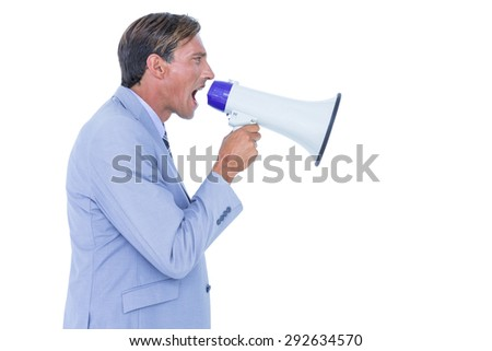 Handsome businessman talking through megaphone