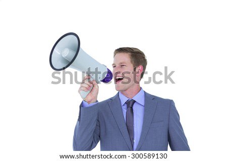 Handsome businessman talking through megaphone - stock photo