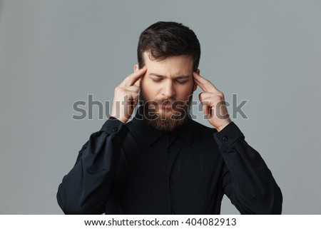 Handsome businessman thinking over gray background