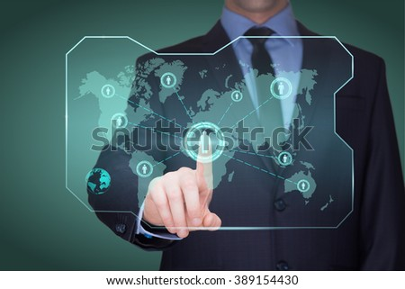 handsome businessman touching a world map on the screen showing global connection between different continents.  - stock photo