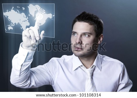 Handsome businessman using a modern touch screen