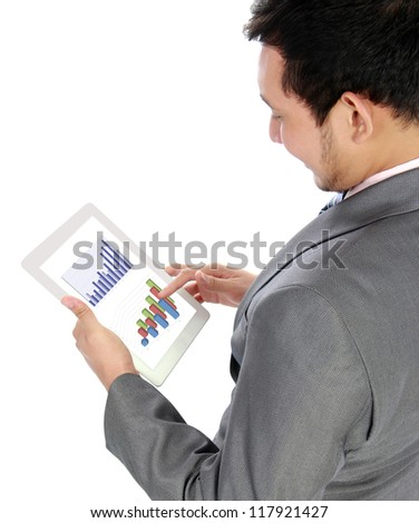 Handsome businessman using his digital tablet