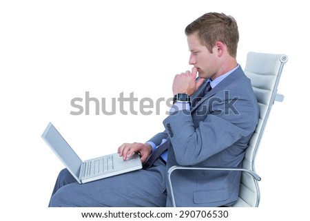 Handsome businessman using his laptop on a white background