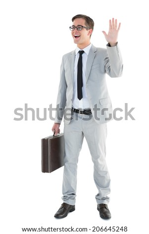 Handsome businessman waving and smiling on white background