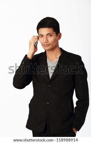 handsome businessman with a smartphone isolated over a white background