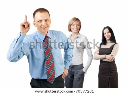Handsome businessman with finger pointing up and his colleagues standing behind him - stock photo