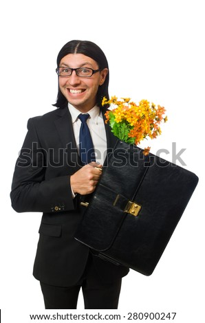 Handsome businessman with flower and brief case isolated on white