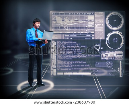Handsome businessman with laptop on technology background - stock photo