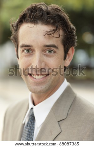 Handsome businessman with messy hair - stock photo