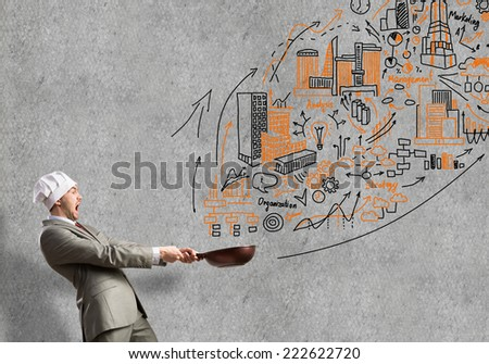 Handsome businessman with pan wearing cook hat - stock photo