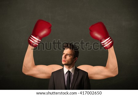 Handsome businessman with strong and muscled boxer arms concept - stock photo