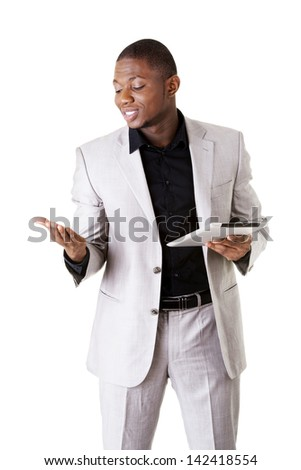 Handsome businessman working on tablet computer. Isolated on white.