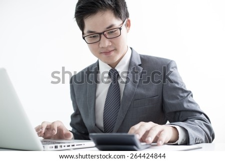 Handsome businessman working with laptop - stock photo