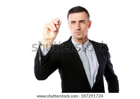 Handsome businessman writes with pen at copyspace over white background - stock photo