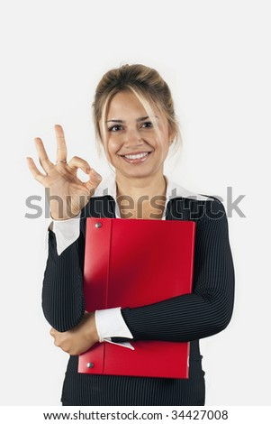 Handsome businesswoman doing fine sign with his hand