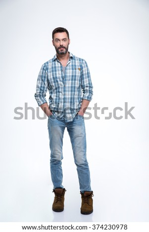 Handsome casual man standing isolated on a white background and looking at camera - stock photo