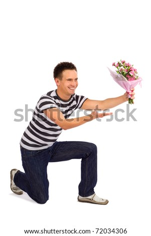 Handsome casual young man handing over bouquet of carnation flowers on Valentine Day, isolated on white background - stock photo