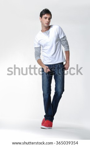 Handsome casual young man smiling - isolated posing in studio - stock photo
