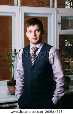 Handsome Caucasian Man In Business Attire Staying In Room Near Window - stock photo