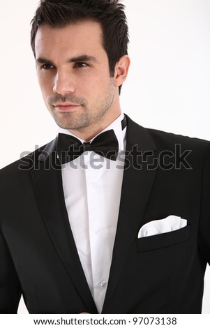 Handsome caucasian man in tuxedo - stock photo