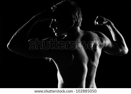 Handsome caucasian man posing, black and white image - stock photo